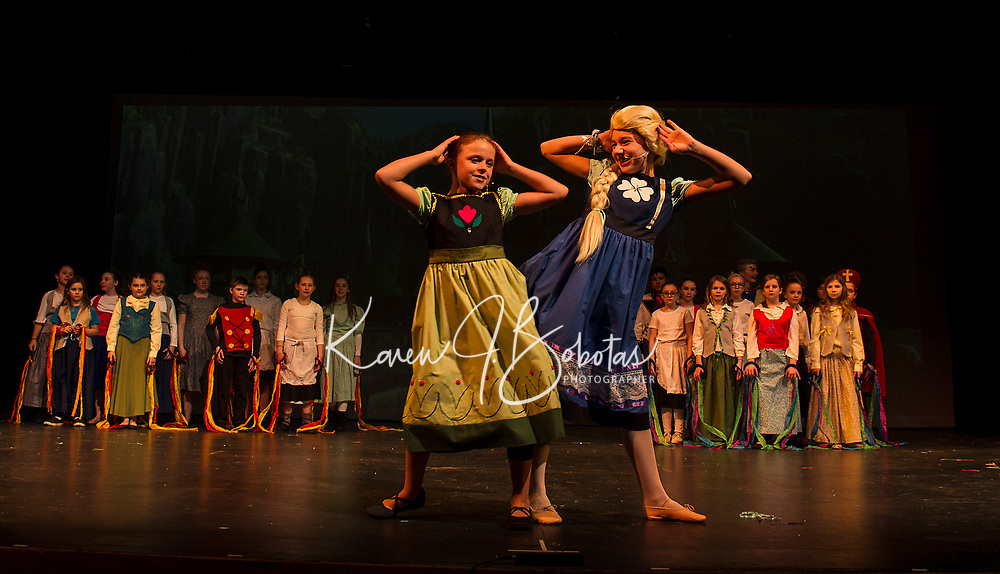"""Little Anna (Anna Coapland) and Little Elsa (Sydney Eastman) on stage for """"Frozen"""" during dress rehearsal with Gilford Middle School on Wednesday.  (Karen Bobotas/for the Laconia Daily Sun)"""