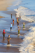 Fishermen line up to catch speckled trout at Kitty Hawk Pier.