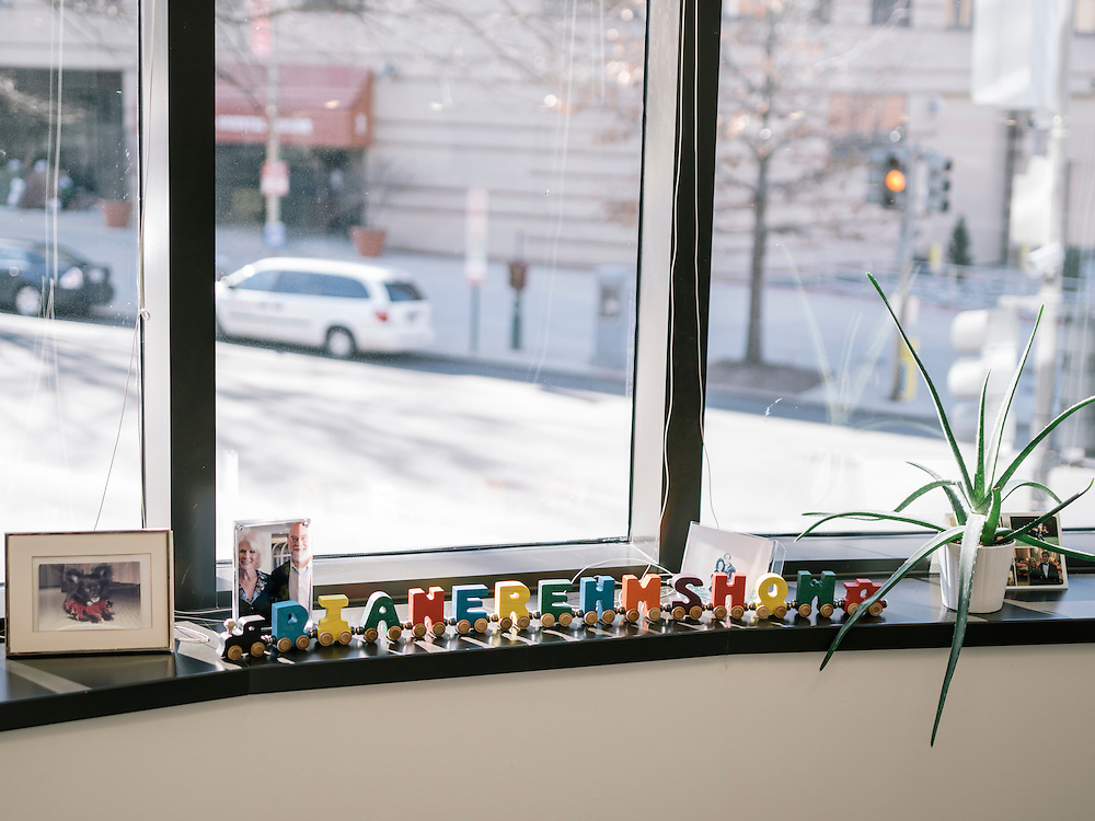 Toy train cars spell out Diane Rehm Show which sits on the window sill in her office in Washington, D.C.