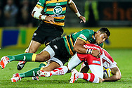 Luther Burrell of Northampton Saints (centre) tackles during the Aviva Premiership match at Franklin's Gardens, Northampton<br /> Picture by Andy Kearns/Focus Images Ltd 0781 864 4264<br /> 05/09/2014