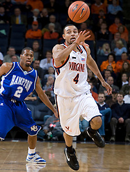 Virginia guard Calvin Baker (4) goes for a loose ball against Hampton.  The Virginia Cavaliers men's basketball team defeated the Hampton Pirates 79-65 at the John Paul Jones Arena in Charlottesville, VA on December 19, 2007.