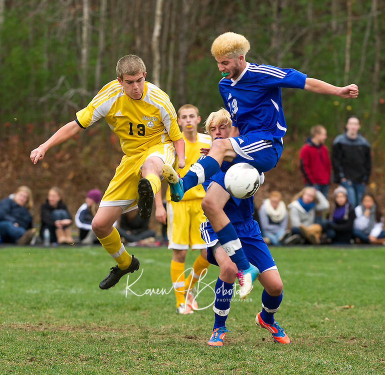 Bow's Robert Lougee and Gilford's Jackson Hillgrove scramble for control of the ball during NHIAA Division III quarterfinal action Sunday afternoon.  (Karen Bobotas/for the Concord Monitor)