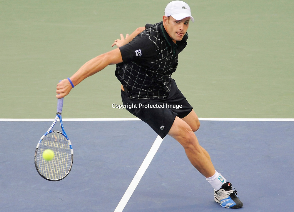 Andy Roddick runs down a shot against Jason Isner during their semi-final match in the Legg Mason Tennis Classic in Washington.
