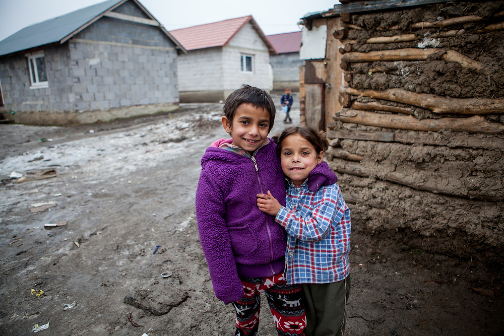The children posing for a photograph at the Roma settlement in Ostrovany.