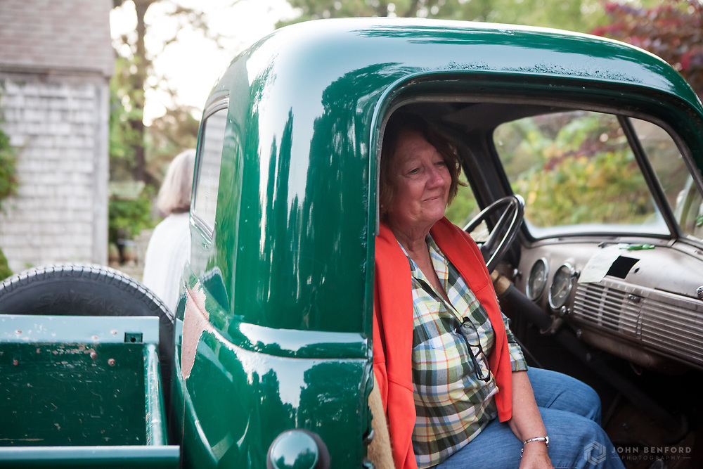 A guest enjoys a reflective moment in Cinda Gaynor's antique pickup truck at her gardens in Nantucket.
