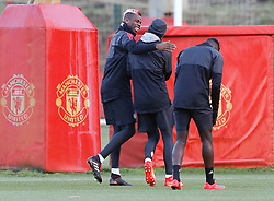 Manchester United's Paul Pogba (left) shares a joke during the training session at the AON Training Complex, Carrington.
