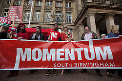 © Licensed to London News Pictures. 02/10/2016. Birmingham, UK. Momentum supporters attend the People's Assembly national demonstration against the policies of Britain's Conservative government. The Conservative Party conference begins today at the ICC in Birmingham and is the first under the leadership of Prime Minister Theresa May, who took over after David Cameron's resignation in July 2016. Photo credit: Rob Pinney/LNP