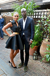 OZWALD BOATENG and LOUISE HAZEL at the Warner Music Group Summer Party in association with British GQ held at Shoreditch House, Ebor Street, London E2 on 8th July 2015.