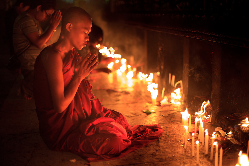 "A monk pray in Kyaiktiyo Pagoda ""Golden Rock"" in Kyaiktiyo Mon state, Myanmar, Saturday, May 11, 2013."