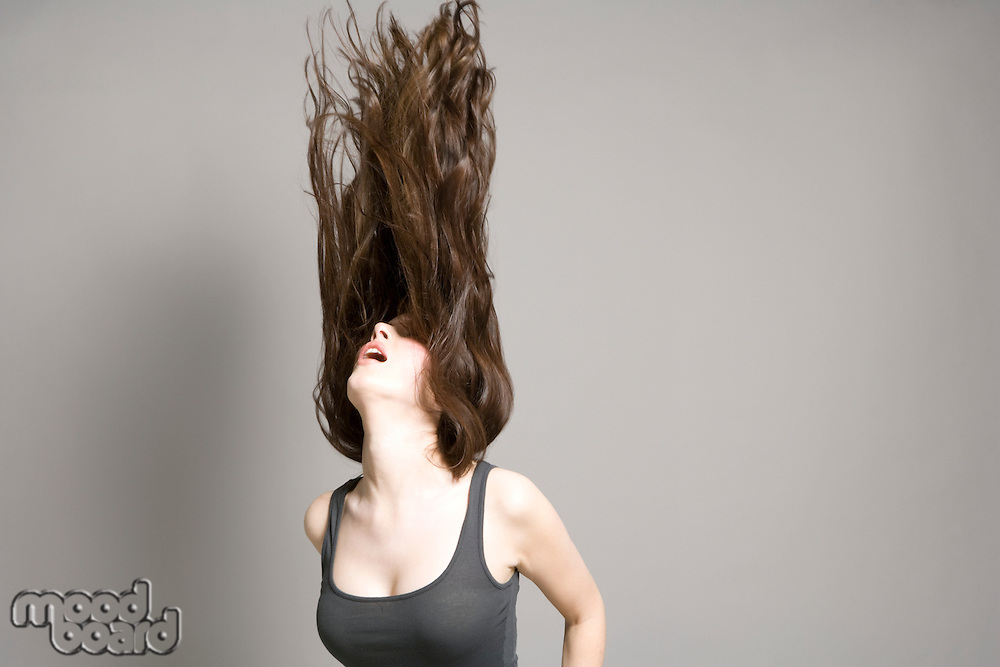 Woman tossing long brown hair