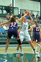 06 December 2017:  Maddie Merritt works the far lane against defender Jill Berg during an NCAA women's basketball game between the Wheaton Thunder and the Illinois Wesleyan Titans in Shirk Center, Bloomington IL