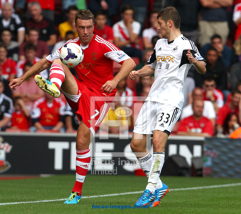 Picture by Paul Terry/Focus Images Ltd +44 7545 642257<br /> 06/10/2013<br /> Rickie Lambert of Southampton and Ben Davies of Swansea City during the Barclays Premier League match at the St Mary's Stadium, Southampton.