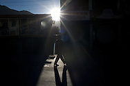 A man walks down the main street in Kargil early in the morning