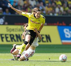 30-04-2011 VOETBAL: BORISSIA DORTMUND - FC NURNBERG: DORTMUND<br /> Kevin Grosskreutz (Dortmund GER #19) vs Juri Judt (1. FC Nurnberg)<br /> ***NETHERLANDS ONLY***<br /> ©2011- FotoHoogendoorn.nl/nph-Scholz