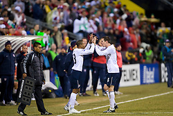 United States midfielder Ricardo Clark (13) is subbed in for United States midfielder Sacha Kljestan (16). The United States men's soccer team defeated the Mexican national team 2-0 in CONCACAF final group qualifying for the 2010 World Cup at Columbus Crew Stadium in Columbus, Ohio on February 11, 2009.