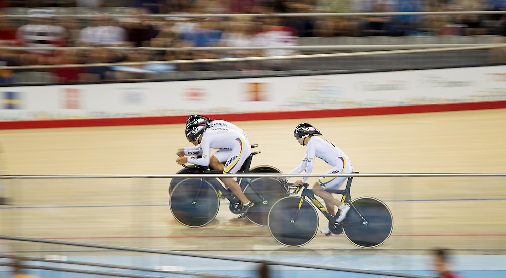The Colombian men's team races to a Gold medal in the cycling team pursuit at the 2015 Pan American Games in Toronto, Canada, July 19,  2015.  AFP PHOTO/GEOFF ROBINS