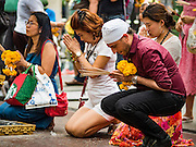 16 AUGUST 2016 - BANGKOK, THAILAND: People pray at Erawan Shrine one year after the shrine was bombed in the worst international terrorist attack in Thai history. On 17 August 2015, a bomb was set off at the Erawan Shrine, a popular tourist attraction and important religious shrine in the heart of the Bangkok shopping district. According to the Royal Thai Police  20 people were killed in the bombing and 125 injured. Thai Police arrested an alleged Uighur extremist for the bombing. The case against him is still pending in Thai courts. The shrine was repaired, rededicated and reopened to the public on 4 September 2015.       PHOTO BY JACK KURTZ