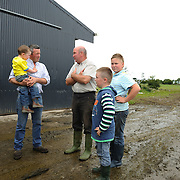 Irish farmer Enda Doran chats with his friend and neighbor outside a farm in Ballinasloe, Co. Galway...Mr. Doran is the eldest of 3 brothers and sisters and by tradition the heritor of the family farming land and business. His farming activities involve cereal and potato production, cattle and sheep breathing and contract work for other farmers.