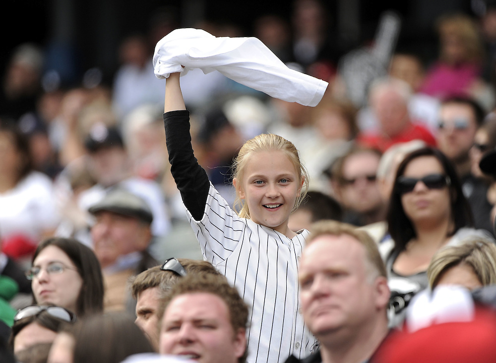 CHICAGO - MAY 01:  A young White Sox fan waves her rally towel during the game between the Chicago White Sox and Baltimore Orioles on May 01, 2011 at U.S. Cellular Field in Chicago, Illinois.  The Orioles defeated the White Sox 6-4.  (Photo by Ron Vesely)