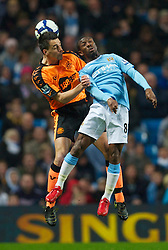 WIGAN, ENGLAND - Monday, March 29, 2010: Manchester City's Shaun Wright-Phillips and Wigan Athletic's Paul Scharner during the Premiership match at the City of Manchester Stadium. (Photo by David Rawcliffe/Propaganda)