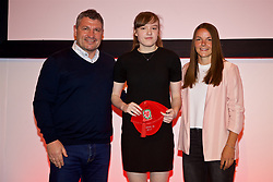 NEWPORT, WALES - Saturday, May 19, 2018: Grace Corne is presented with her Under-16's cap by Osian Roberts (left) and Lauren Dykes (right) during the Football Association of Wales Under-16's Caps Presentation at the Celtic Manor Resort. (Pic by David Rawcliffe/Propaganda)