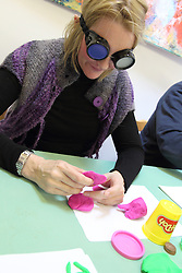 Staff wearing simulation goggles making tactile sample designs at consultation over rebranding of charity NRSB to Mysight.