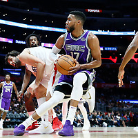 12 October 2017: Sacramento Kings guard Garrett Temple (17) drives past LA Clippers forward Wesley Johnson (33) and LA Clippers guard Milos Teodosic (4) during the LA Clippers 104-87 victory over the Sacramento Kings, at the Staples Center, Los Angeles, California, USA.