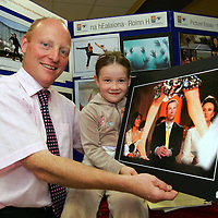 Michael Earley, Deputy Manager AIB and Niamh Kelly, Ennis , viewing a photo by Ennis photographer John Kelly , at the opening of the AIB/ Press Photographers Association of Ireland awards exhibition at the AIB branch, Ennis, Co. Clare .  - Photo : Kieran Clancy / PicSure © 12/9/06