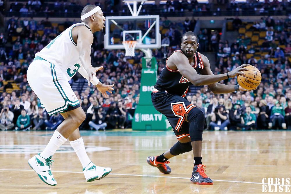 18 January 2013: Chicago Bulls small forward Luol Deng (9) passes the ball past Boston Celtics small forward Paul Pierce (34) during the Chicago Bulls 100-99 overtime victory  over the Boston Celtics at the TD Garden, Boston, Massachusetts, USA.