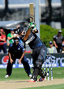Martin Guptill hits a four during the ICC Cricket World Cup match between New Zealand and Scotland at university oval in Dunedin, New Zealand. Photo: Richard Hood/photosport.co.nz