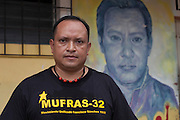 Hector Berrios, general coordinator of MUFRAS-32 and anti-mining activist, stands next to a mural of murdered anti-mining activist and former friend Marcelo Rivera. Pacific Rim's controversial El Dorado gold mine has been the focus of numerous social conflicts at local and national level. Three anti-mining local leaders were murdered in 2009. While a year before, former president Antonio Saca refused to authorize the company's mining permit. This action prompted Pacific Rim to invoked a provision of the Central American Free Trade Agreement (CAFTA) to place the matter in the hands of an international arbitration court. Oceana Gold, who took over Pacific Rim on October 2013 for US $10.2 million , now seeks US $300 million for damages agains the State of El Salvador. San Isidro, Cabañas, El Salvador. September 15, 2014.