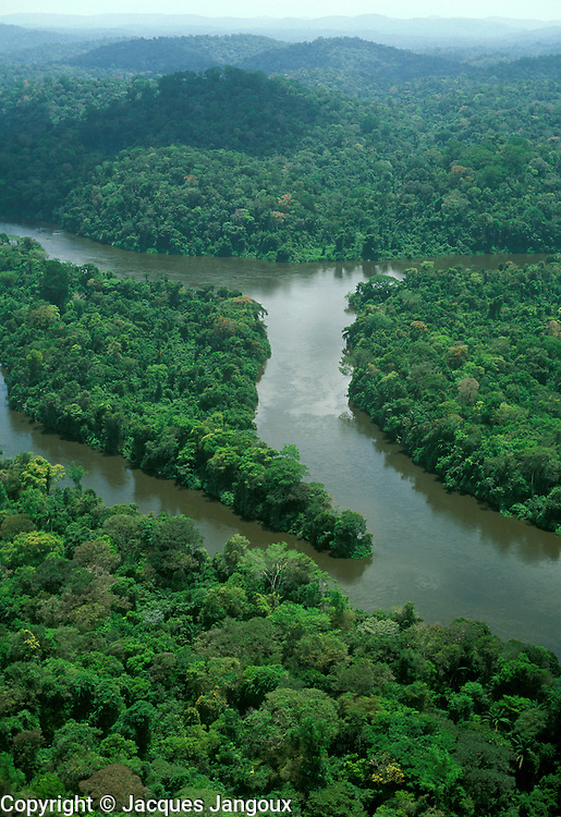 Aerial view of Jari River (tributary of Amazon) coming down from Guyana Highlands and lush rainforest in the Amazon region, Brazil (border between Para and Amapa)
