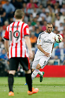 Karim Benzema of Real Madrid and Muniain of Athletic de Bilbao during La Liga match between Real Madrid and Athletic de Bilbao at Santiago Bernabeu stadium in Madrid, Spain. October 05, 2014. (ALTERPHOTOS/Caro Marin)
