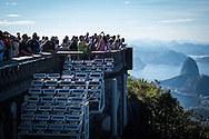 Visitors take in the view at the Cristo Redentor (Christ statue) at the top of the hill in Rio de Janeiro, Brazil. Photo by Andrew Tobin/Tobinators Ltd