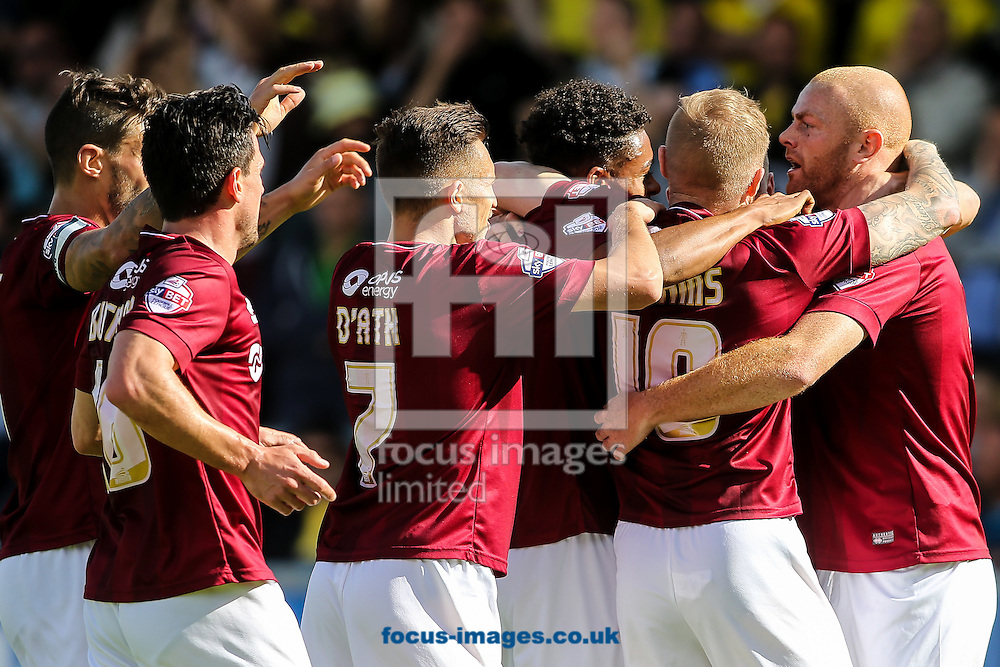 Northampton players celebrate their first goal  during the Sky Bet League 2 match at Sixfields Stadium, Northampton<br /> Picture by Andy Kearns/Focus Images Ltd 0781 864 4264<br /> 12/09/2015
