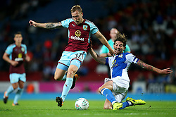 Blackburn Rovers' Charlie Mulgrew slide tackles Scott Arfield of Burnley - Mandatory by-line: Matt McNulty/JMP - 23/08/2017 - FOOTBALL - Ewood Park - Blackburn, England - Blackburn Rovers v Burnley - Carabao Cup - Second Round