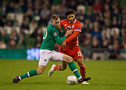 DUBLIN, IRELAND - Tuesday, October 16, 2018: Republic of Ireland's captain Richard Keogh (L) pushes Wales' Tyler Roberts off the pitch during the UEFA Nations League Group Stage League B Group 4 match between Republic of Ireland and Wales at the Aviva Stadium. (Pic by David Rawcliffe/Propaganda)