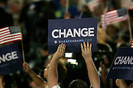 Change signs as Barak Obama speaks at the last night of the Democratic Convention in Denver, Colorado.  Photograph by Dennis Brack