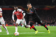 Rennes Hatem Ben Arfa (18) and Arsenal Midfielder Ainsley Maitland-Niles (15) in action during the Europa League round of 16, leg 2 of 2 match between Arsenal and Rennes at the Emirates Stadium, London, England on 14 March 2019.