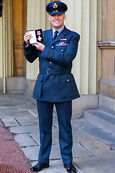 ROTA:  Squadron Leader Ian Dornan proudly display his Air Force Cross awarded for saving his Tornado aircraft and crew following the loss of power due to an engine fault at an investiture at Buckingham Palace in London. London, November 13 2018.