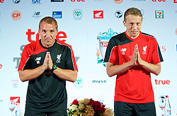 BANGKOK, THAILAND - Monday, July 13, 2015: Liverpool's manager Brendan Rodgers and Lucas Leiva greet the Thai media during a press conference at the Plaza Athenee team hotel in Bangkok on day one of the club's preseason tour. (Pic by David Rawcliffe/Propaganda)