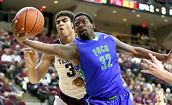 Florida Gulf Coast University's Antravious Simmons rebounds a ball against Texas A&M's Tyler Davis (34) during a NCAA college basketball game in College Station, Texas, Wednesday, Dec. 2, 2015.  (AP Photo/Sam Craft)