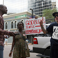 A man on the street argues with a member of the Bible Believers group during the Republican National Convention in Tampa, Fla. on Wednesday, August 29, 2012. (AP Photo/Alex Menendez)