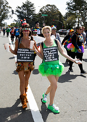 Pocahon Tits and Drinkerbell pose for a photograph at the 107th running of the Bay to Breakers, Sunday, May 20, 2018, in San Francisco. (Photo by D. Ross Cameron)