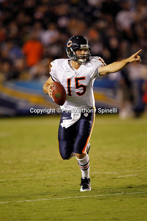 Chicago Bears rookie quarterback Dan LeFevour (15) points as he rolls out while looking to pass during a NFL week 1 preseason football game against the San Diego Chargers, Saturday, August 14, 2010 in San Diego, California. The Chargers won the game 25-10. (©Paul Anthony Spinelli)