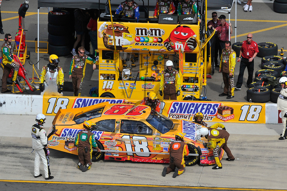 Brooklyn, MI - JUN 17, 2012: Kyle Busch (18) makes a pit stop during race action for the Quicken Loans 400 race at the Michigan International Speedway in Brooklyn, MI.