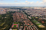 Nederland, Zuid-Holland, Den Haag, 15-07-2012; Kijkduin, links Westduinpark. Vogelwijk met in de voorgrond Laan van Poot. Diagonaal naar boven, beginnend met de sportvelden, de Sportlaan. Aan weerszijden van de Sportlaan de 'Atlantikwall strook'. In dit gebied is tijdens de Tweede Wereldoorlog de bevolking geëvacueerd en de bebouwing ontruimd en/of gesloopt ivm aanleg tankgracht..On both sides of the Sportlaan the Atlantic Wall strip. During the Second World War, the population of this area was evacuated and some of the buildings were demolished in order to build a antitank ditch...QQQ.luchtfoto (toeslag), aerial photo (additional fee required).foto/photo Siebe Swart