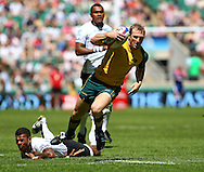 Twickenham, London - Sunday 23rd May 2010: Australia's James Stannard beats a tackle to score a try against Fiji during the quarter finals of the Emirates London Sevens rugby tournament at Twickenham Stadium, London, UK. (Pic by Andrew Tobin/Focus Images)