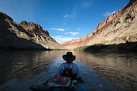 A canoeist takes in the view of Stillwater Canyon and the Colorado River near its confluence with the Green River in Canyonlands National Park, Utah.