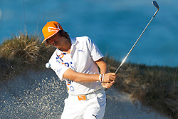 Feb 8, 2012; Pebble Beach CA, USA; Rickie Fowler hits a bunker shot on the fourth hole during the practice round of the AT&T Pebble Beach Pro-Am at Pebble Beach Golf Links. Mandatory Credit: Jason O. Watson-US PRESSWIRE